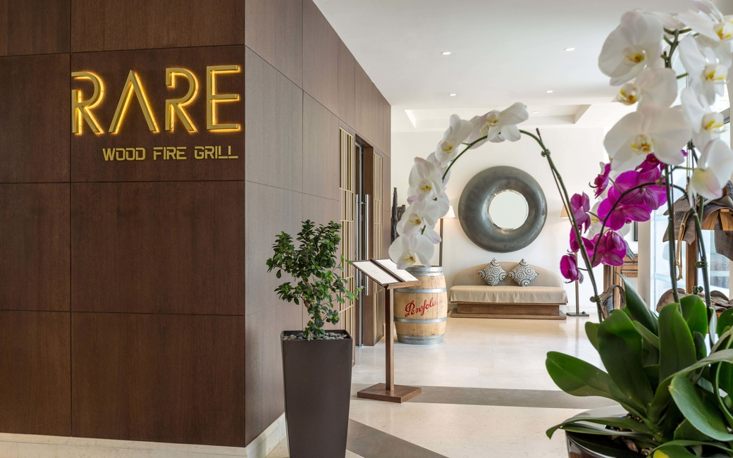 Dining options include the Rare Oak Wood Fire Grill which serves chargrilled meats and seafood