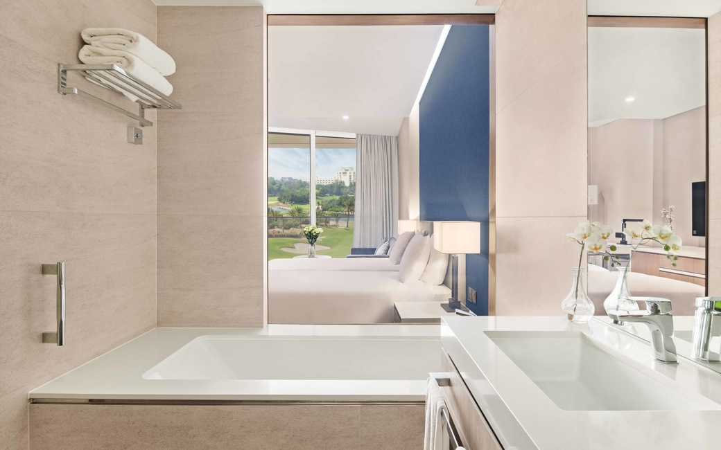 The course view room also features twin beds and an en-suite bathroom