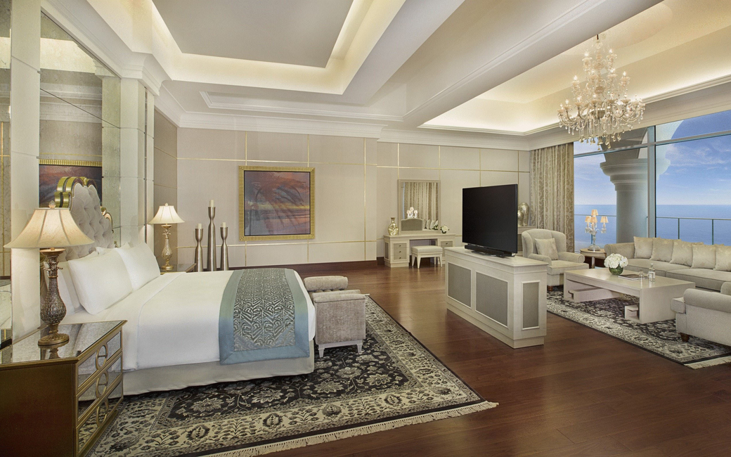 Rooms include King and Queen Deluxe and Superior rooms as well as Pearl Club rooms, offering views of the sea and skyline