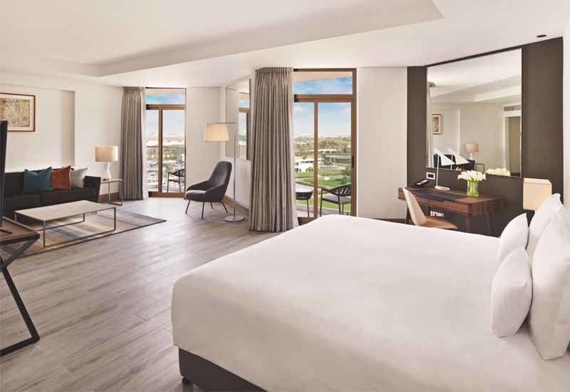 The bedrooms have been renovated with modern wood tile flooring