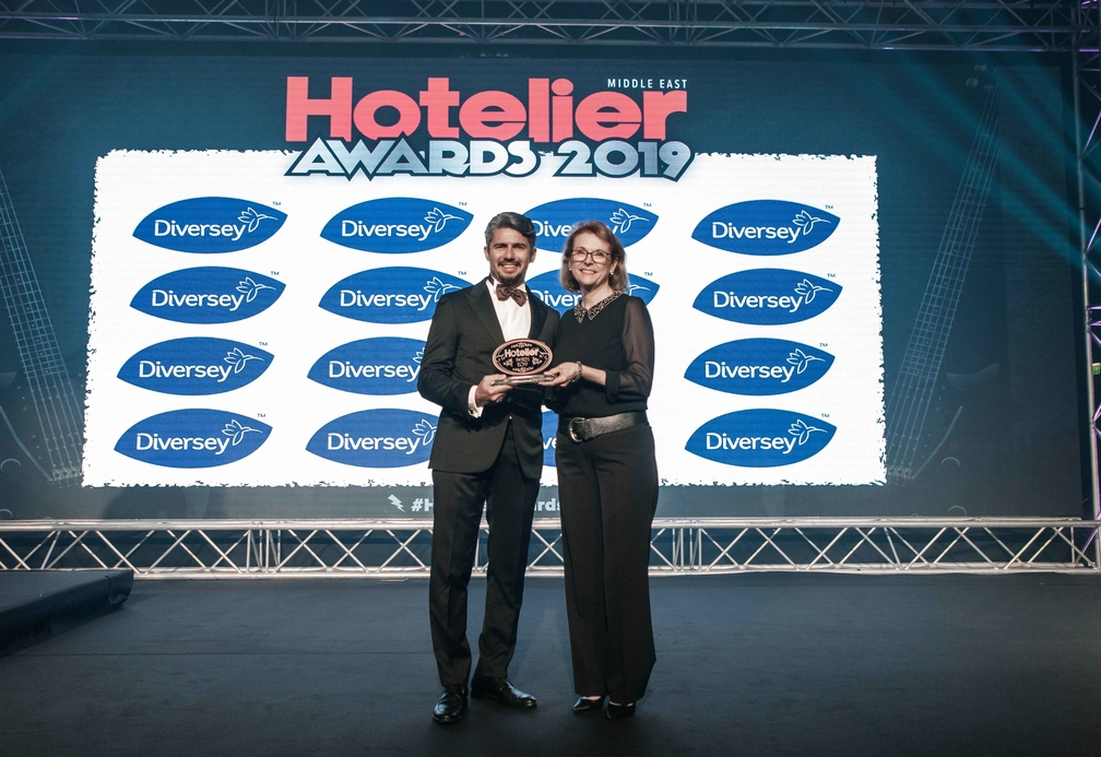 Tatjana Ahmed accepts her award on stage at the Hoetlier Middle East Awards 2019