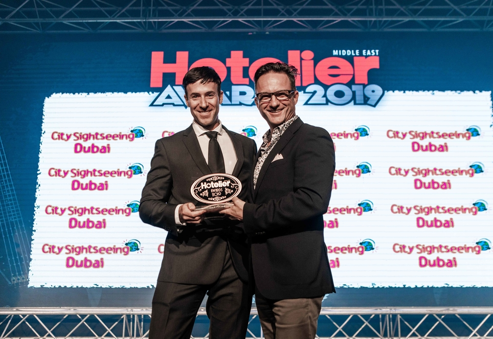 Daryn Berriman accepts his award on stage at the Hotelier Middle East Awards