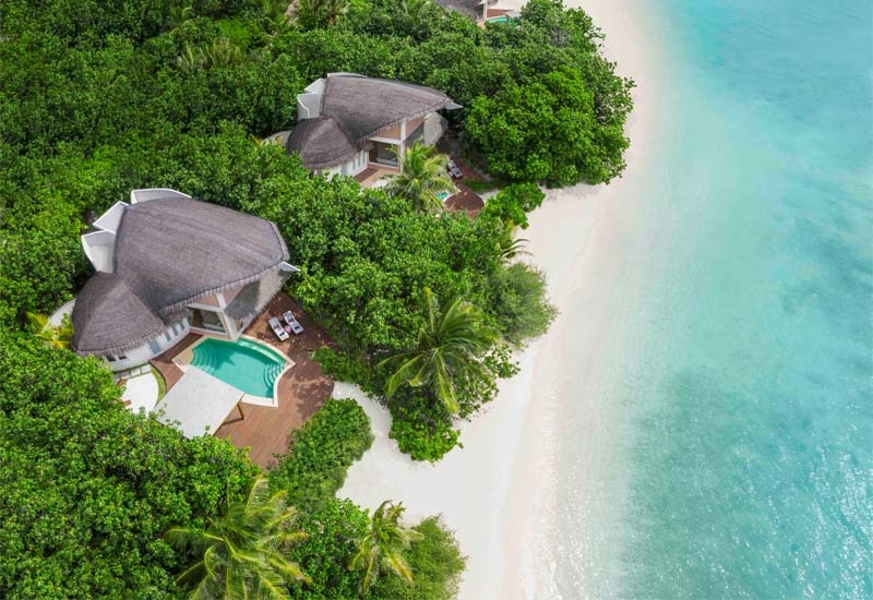 Thatched roofs on villas are reminiscent of inverted dhoni boats, the traditional Maldivian wooden fishing vessels, and slanted roof tips recall white herons dipping their heads into the water
