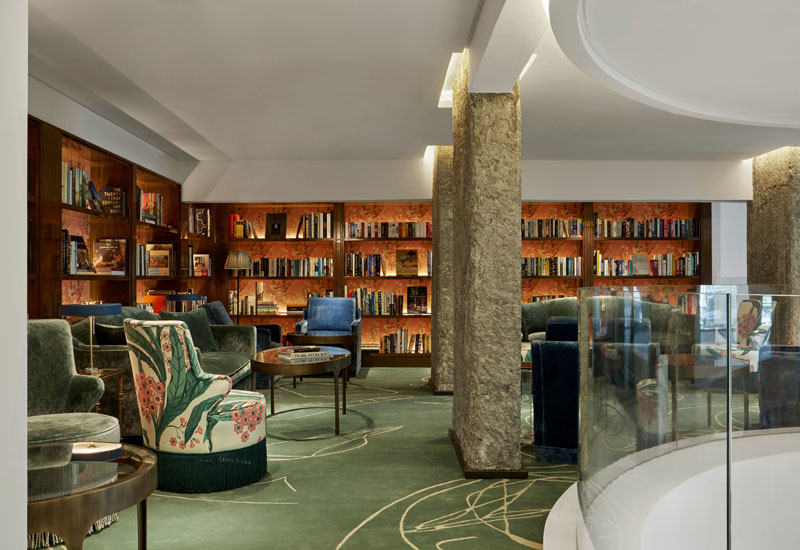 Tea is served at the boutique's library, a mezzanine overlooking the lobby