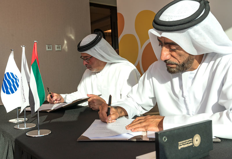 Essa Bin Hadher, general manager of Dubai College of Tourism, and Mohammed AlHashmi, chief technology officer of Expo 2020 Dubai sign the agreement