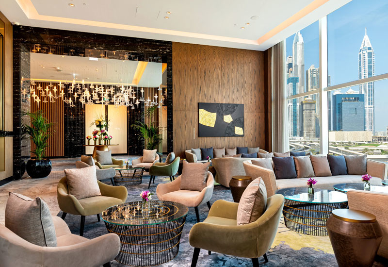 Brass and vibrant textiles are used throughout the hotel
