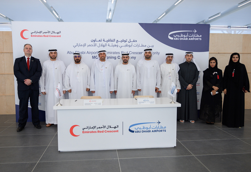 The agreement was signed in the Midfield terminal building