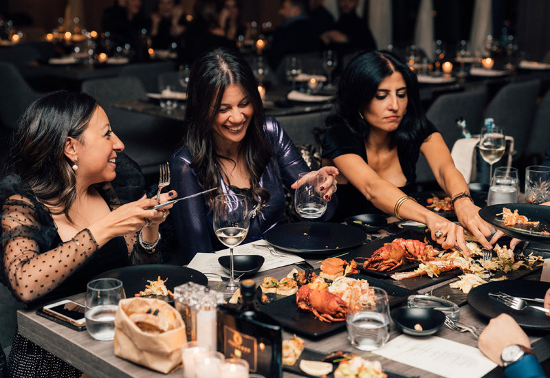 The restaurant features a Mediterranean and Italian menu, with dishes such as squid ink black cod and roasted Alaskan king crab