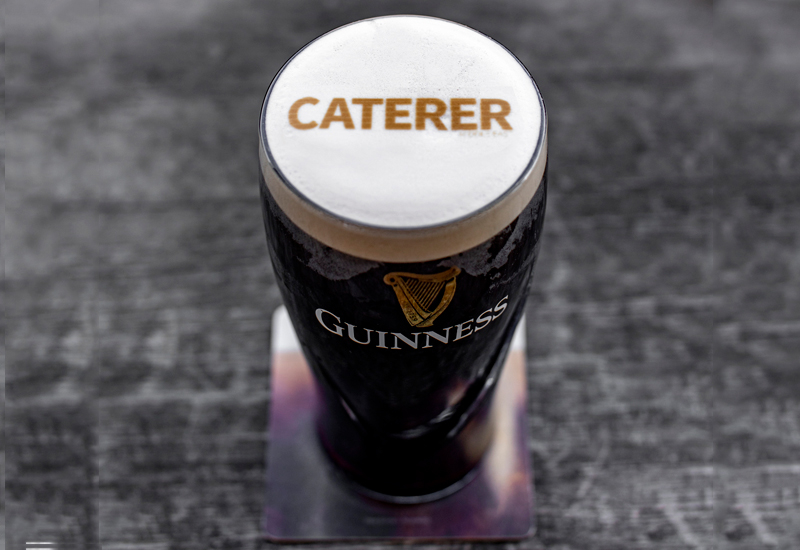 The Caterer Middle East logo printed onto a pint of Guinness