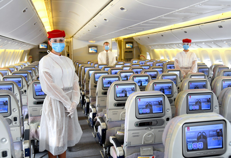 Emirates Airline crew in the mandatory protective equipment