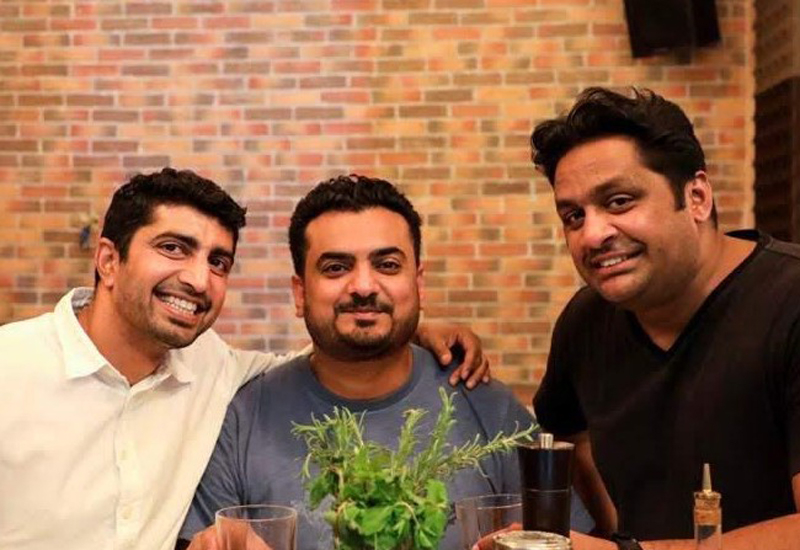 Abdul Hakim (middle) with his fellow co-owners