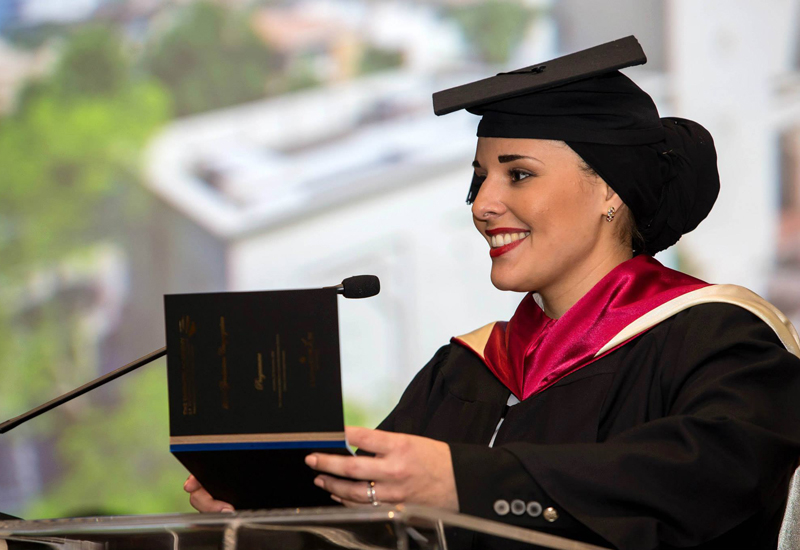 Annelie alhallaq Bea gives the valedictorian speech at her graduation ceremony