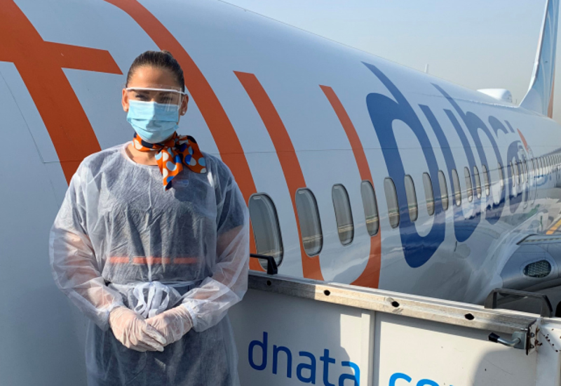 A Flydubai crew member wearing personal protection equipment
