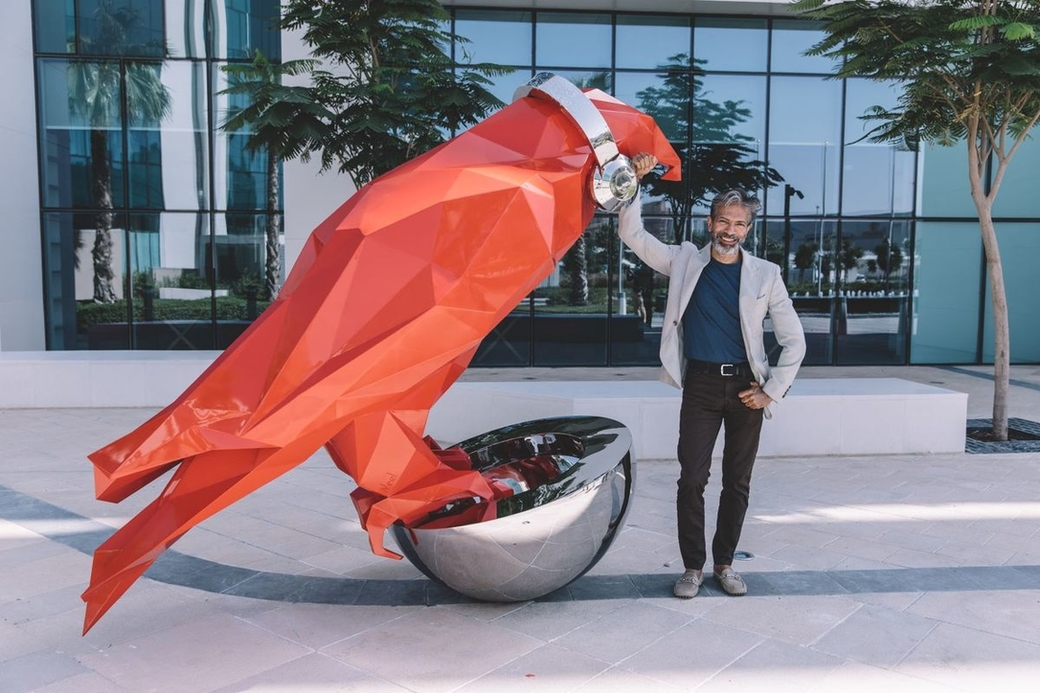 Neel Shukla and his falcon sculpture at the region's first Radisson RED hotel in Dubai